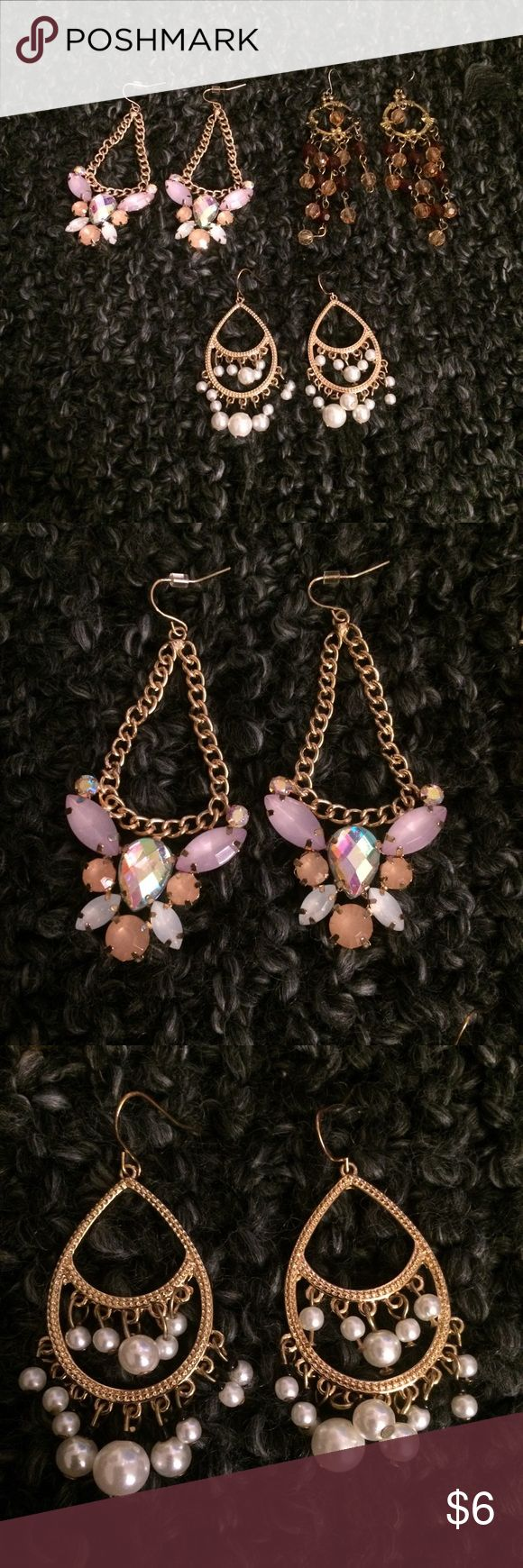 Lot of 3 Chandelier Earrings - EUC. Worn a few times, just downsizing my enormous earring collection! - Super cute pink rhinestone/gold chandelier earrings - Burgundy & light orange chandelier earrings with black distressing on gold hoops. Bought them for a pirate Halloween costume! - Gold chandelier earrings with dangling pearls accented by black beads. Classic & go with anything! Accessories