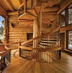 Beautiful wooden staircase in log cabin