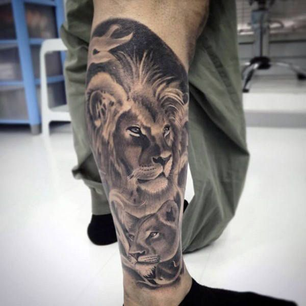 Popular Tattoos And Their Meanings Lion Leg Tattoo Lion Tattoo Mens Lion Tattoo