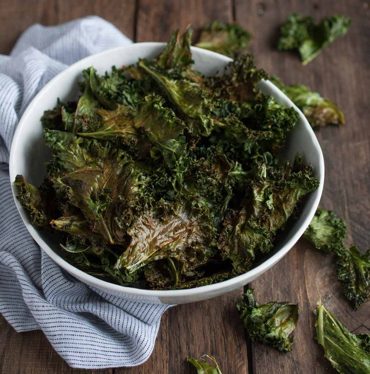 Roasted kale chips are given a touch of cajun spice and then baked until crispy. This recipe makes two generous servings, each with under 100 calories! -Feasting Not Fasting