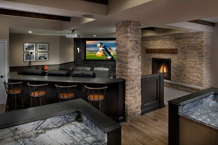 "Transitional Basement with Columns, Vizio M-Series M65-C1 65"" Class Full Array 4K Smart LED TV, stone fireplace, Wall sconce"