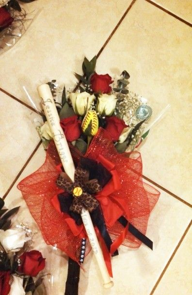 """Angela shares a photo of a bouquet she made for softball senior night. The bouquet includes a miniature bat with her daughter's name and """"Class of 2013″ engraved on it."""