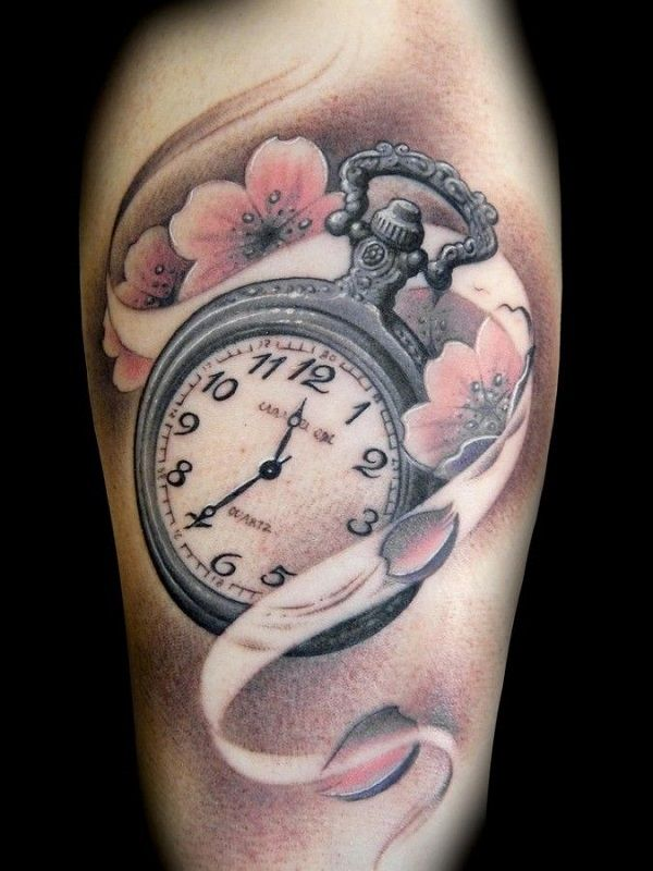 Cherry blossom tattoo with a pocket watch. The pretty cherry blossoms are seen to be enveloping a silver pocket watch emphasizing on the meaning of time and how short it is to live one's life.