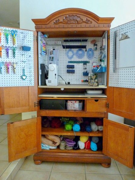 Unused armoire as a craft cabinet. Brilliant! One day I want to have enough crafts to do this!!