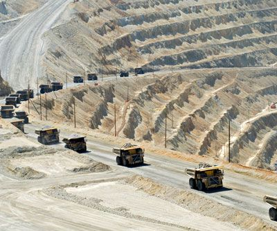 Grasberg mine is the largest gold mine in the world and third largest copper mine in the world   mining_trucks_open pit