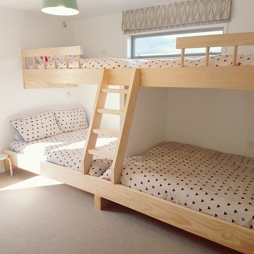 Jaron made the cool set of built-in bunks so there's plenty of space for guests. The walls are Resene Double Alabaster.