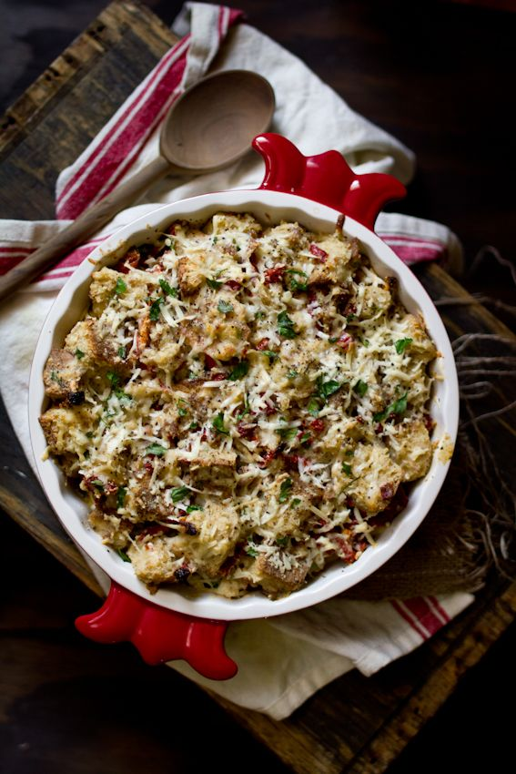 Savory bread pudding with sausage, sun-dried tomatoes, cheddar, and aged gouda.