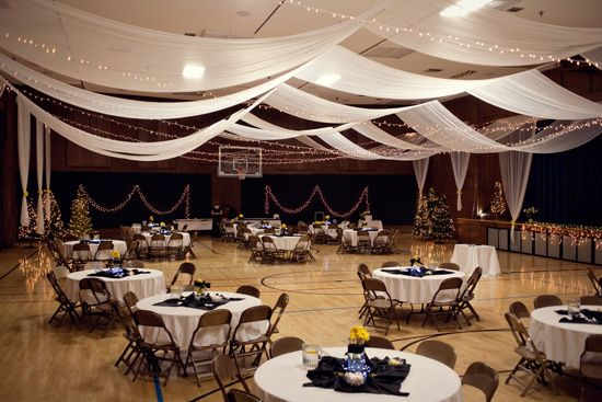 Church gym draped and decorated into a wedding reception