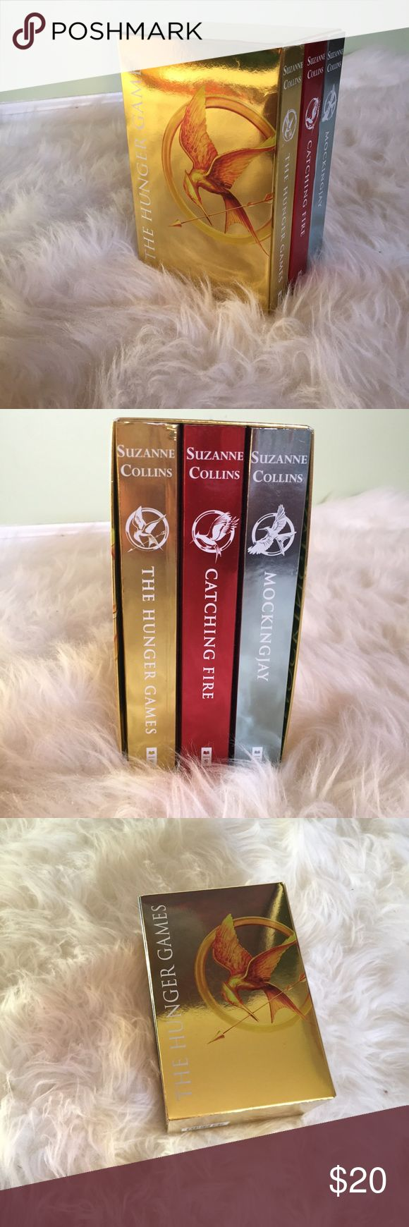 The Hungers Games Book Series All 3 Hunger Games books with shiny covers! Only problem I see is that only the first book (gold) was used so there is a bend at the top right corner of the cover... The other 2 books were not touched and are in perfect condition. Other