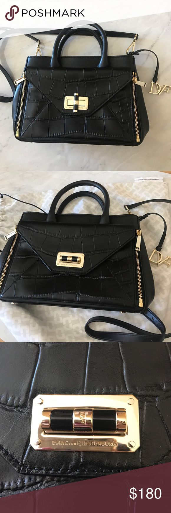 Diane Von Furstenberg mini cross body bag DVF bag, comes with dust bag. Black with gold hardware. Great deal in a great bag! Only used once, perfect confusion. Comes with Card of Authenticity. 8inches x 11inches x 5inches wide. Tags are all in the bag. Diane Von Furstenberg Bags Crossbody Bags