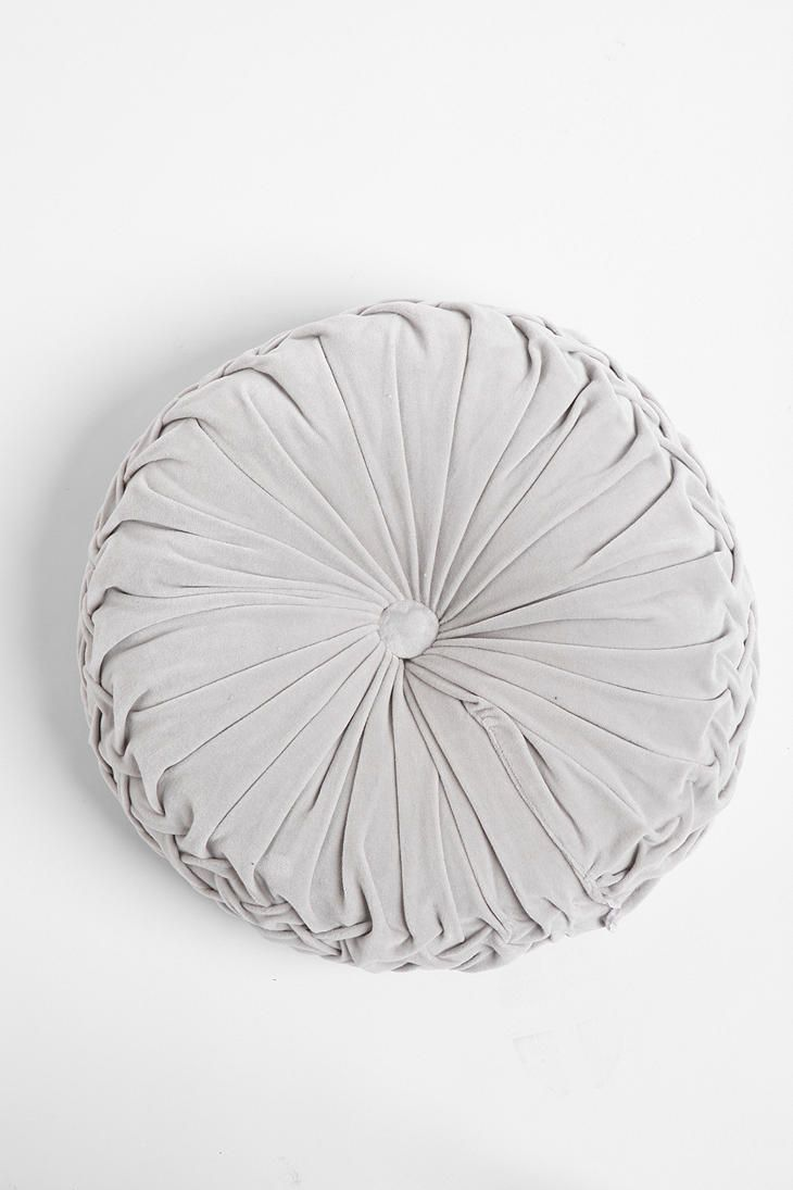 Circular gray pillow.