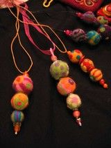 TOP: Needle felted necklaces, created by Cathy Smay. RIGHT: Notecards with needle felted paintings.