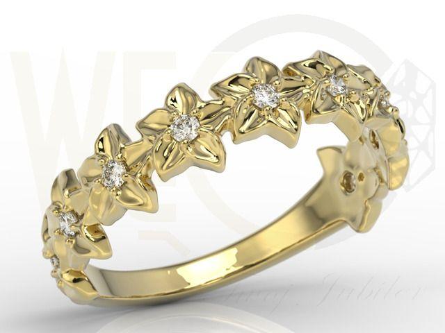 Pierścionek w formie kwiatu z żółtego złota z cyrkoniami./ Ring in the form of a flower of yellow gold with zircons./1 017,00 PLN.