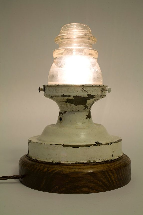Vintage telephone insulator used as glass globe for salvaged light fixture or lamp.  Upcycle, recycle, repurpose, salvage, diy!  For ides and goods shop at Estate ReSale  ReDesign, Bonita Springs, FL