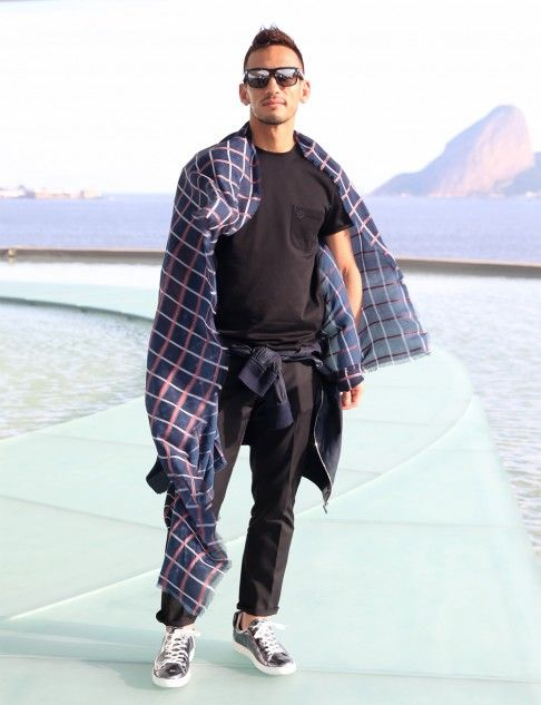 Former soccer star Hidetoshi Nakata channelling sports chic at Louis Vuitton's latest cruise fashion show in Riode Janeiro.