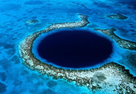 12 truly mesmerizing places |  The Great Blue Hole at Lighthouse Reef Ambergris Caye, Belize