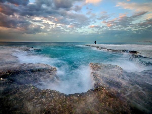 Winter Waves by Ilan Shacham via nationalgeographic: A lone fisher stands at the tip of a rocky outcrop on Israel's Palmachim Beach as ocean waves crash around him. #Israel #Palmachin_Beach #Ilan_Shacham #nationalgeographic