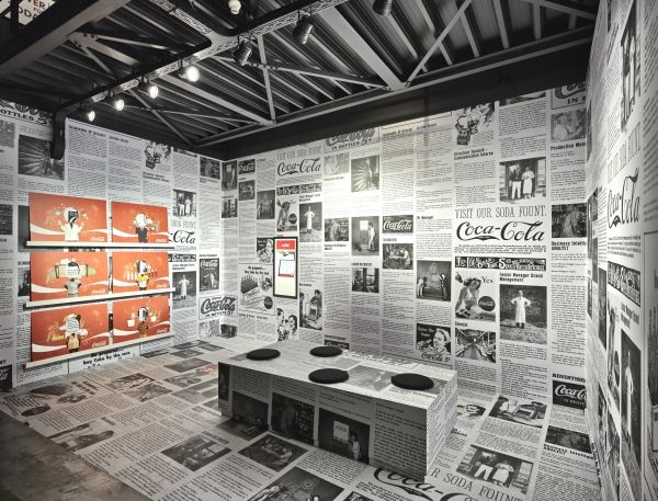 Tell your brand story through by plastering an exhibit booth or office space with old advertisements.