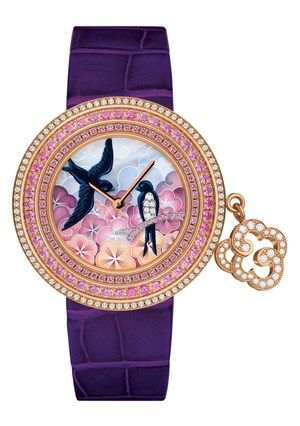 Van Cleef & Arpels 'Charms Extraordinaire' Hirondelles in pink gold case, with diamonds. Bezel set with pink and violet sapphires. Dial includes miniature painting on mother-of-pearl, diamonds and violet sapphires. Limited to 22 pieces.