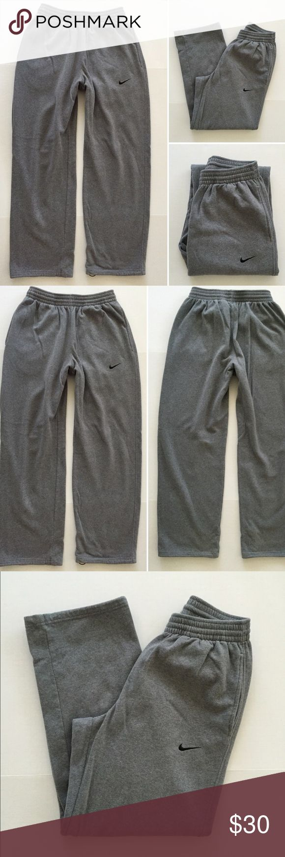 "[Nike] men's athletic gray jogger sweatpants L [Nike] men's athletic gray jogger sweatpants L •🆕listing •good pre-owned condition •grey with black embroidered insignia •length/inseam 31.5"" •2 front pockets, pant leg bottoms adjustable cinching closure •material 80% cotton 20% polyester, very soft fleece sweats •Very subtle wear to bottoms of pant legs on interior •Offers welcomed using the offer feature or bundle for the best discount••• Nike Pants Sweatpants & Joggers"