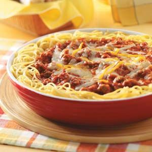 Sausage Spaghetti Pie Skillet Recipe- Recipes  I have made freezer meals for years now, and this is by far my most requested. In fact, I like to make several of these Italian pies at one time so we can have one every week for more than a month! With its lasagna-like flavor, this dish is very tasty when it's hot from the oven. —Linda Remillard, Bonaire, Georgia