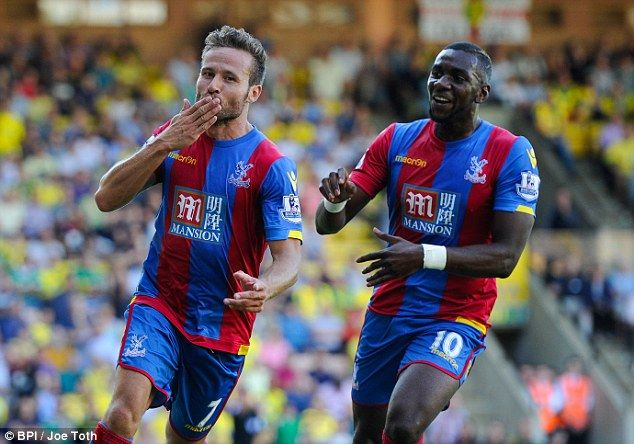 Bolasie congratulates Yohan Cabaye (left) on his injury time goal which cemented three poi...