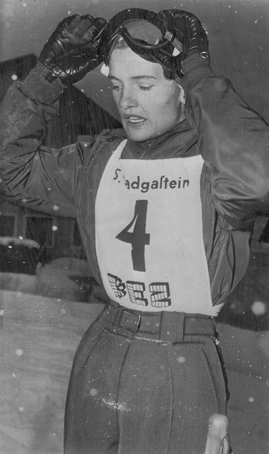 January 27, 1952 Press Photo:  THE WINNER RELAXES – Andrea Mead Lawrence of Rutland, Vt., is shown taking things easy after posting another victory in a tuneup ski match for the Olympics.  The famed woman skier removes her goggles after winning the giant slalom at Bad Gastein, Austria.  She competed against the top women skiers from six nations.