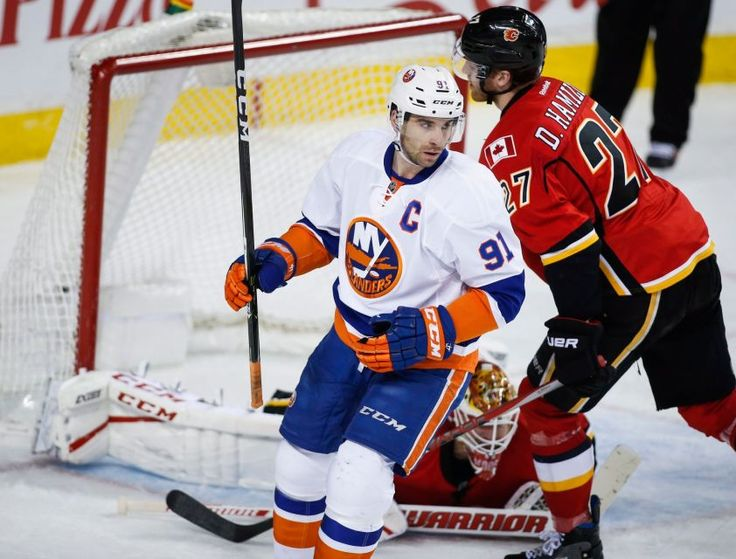 Islanders vs. Flames:     March 5, 2017  -   The Islanders fell to the Calgary Flames, 5-2, on Sunday at the Scotiabank Saddledome.   -      New York Islanders' John Tavares, centre, celebrates after scoring on Calgary Flames goalie Brian Elliott, centre, during second period NHL hockey action in Calgary, Alberta, Sunday, March 5, 2017.