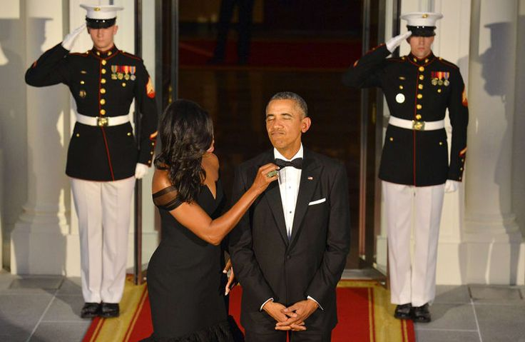 Michelle Obama adjusts her husband's tie as they await the arrival of Chinese President Xi Jinping and his wife, Peng Liyuan, for a state dinner at the White House on Sept. 25, 2015.