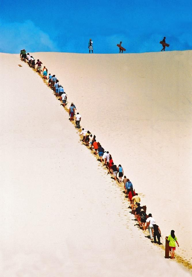 Sand boarding, Moreton Island, Queensland, Australia. Moreton Island is the third largest sand island in the world