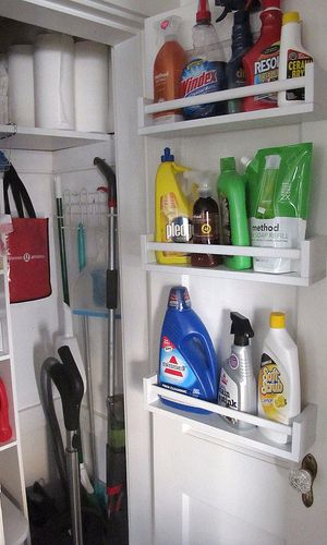 Hang IKEA spice racks on the back of the closet door to store bulky cleaning supplies.                                                                                                                                                                                 More