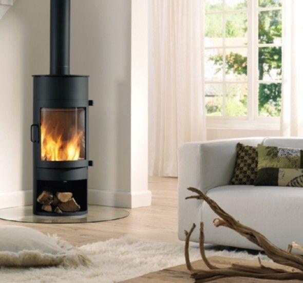 De #Dik #Geurts #Babe is een opvallende h#outkachel dankzij zijn ronde vormen. Het grote gebogen glasraam van de Dik Geurts Babe zorgt voor een optimaal zicht op het vuur. Onder in de Dik Geurts Babe is er een opbergmogelijkheid voor houtblokken. Standaard wordt de Dik Geurts Babe geleverd in de kleur donker antraciet en met een boven- of achteraansluiting. #dikgeurts #Kampen #Fireplace #Fireplaces #Interieur