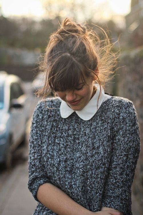 this is how you should wear your peter pan collar with a textured knitted sweater.  so buy it in a white shirt and put this look with grey jeans, remove the jumper and you still look grown up. avoid dresses for peter pan collars.  shirts, yes, then toughen them up with jeans