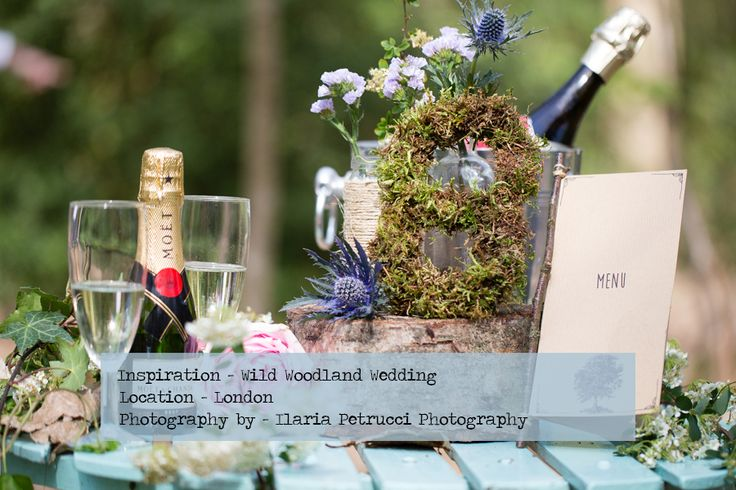 Inspirational photoshoot for a wild, colourful woodland wedding from photographer Ilaria Petrucci for british-bride.co.uk. Flowers, moss, champagne, flower covered umbrella, blue grooms suit, confetti, tree trunk cake stand