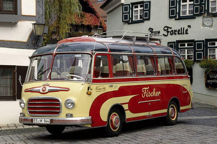 The Setra S 6 belonging to the Fischer Bus Company from Weilheim/Teck, in the fishermen's quarter of Ulm in front of the Setra Museum (left) and the Forelle restaurant