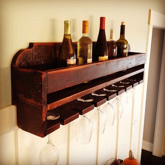 This Rustic Farmhouse WIne rack fits perfectly into any farm or country style home! It can hold up to 8 wine bottles and 8 glasses. It measures
