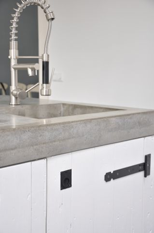 We love the #concrete sink in this #kitchen. www.remodelworks.com