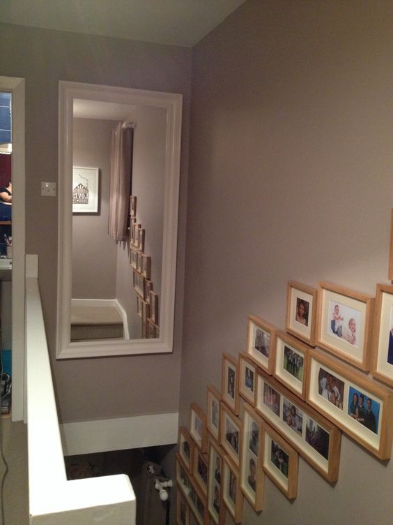 Dulux soft truffle walls. Oversized mirror from ikea. Decorated hall stairs