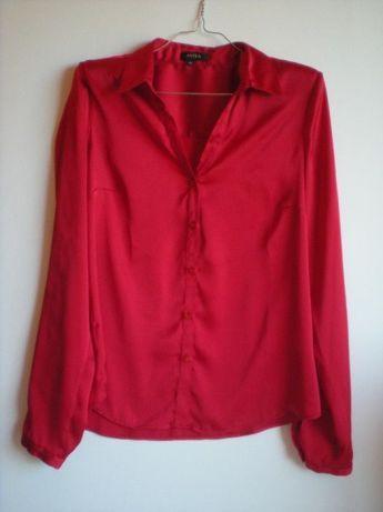 12 €: MARCAS:  Elogy e Easy Wear  DESCRIÇÃO DOS ARTIGOS:  1. Camisas de Cetim Elogy, novas sem etiqueta, vermelhas - Tam. 40, 42 e 44. 2. Camisa de Tecido Easy Wear, nova sem etiqueta, azul - Tam. L  ...