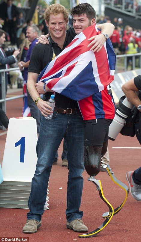 Prince Harry, with team Captain David Henson winner of the 200m race ~~ September 11, 2014
