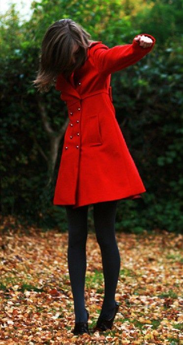 Bright red coat, opaque tights, and heels.  Winter fashion.