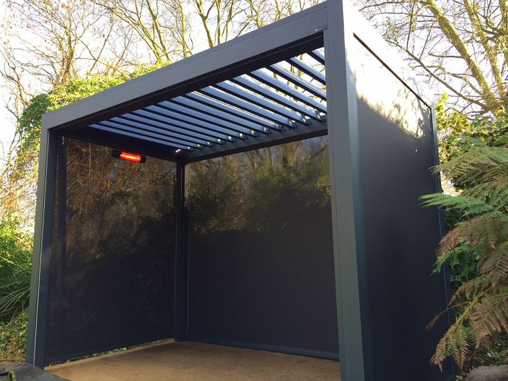 Outdoor Living Pod, Louvered Roof Patio Canopy Installaton in Highgate, London. This Outdoor Living Pod will be used with outdoor gym equipment beneath, creating the perfect all-weather workout space.