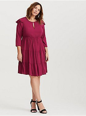 A tiered skirt adds depth to a wine coloured dress complete with ruffle trim and 3/4 length sleeves | Plus Size Clothing | Body Positive Clothing | Plus Size Dresses | Curvy Dresses | Ruffled Dresses | Dresses For Valentine's Day | Torrid Dresses | Torrid - IsabellaBrusilo.com