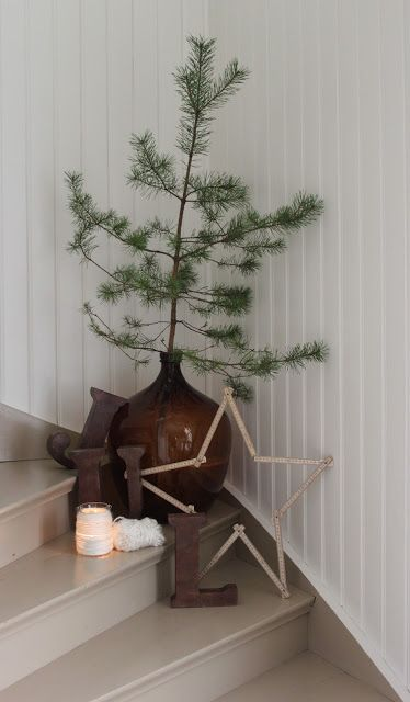 Simple, homey Christmas vignette for the stairs.