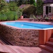 Best 25 faux stone siding ideas on pinterest stone for Above ground pool siding ideas