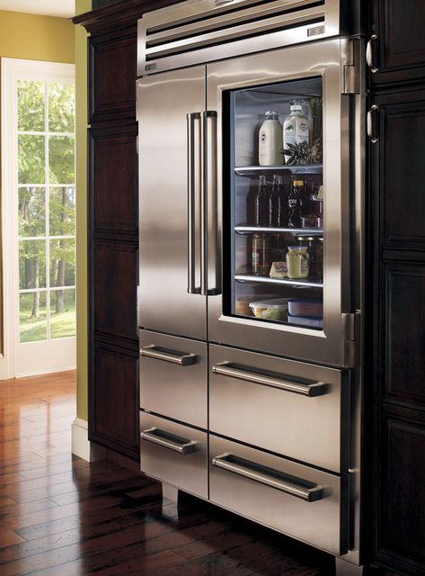 Modern appliances. Big Fridge. Stainless steel. I like the glass door. Lacks an ice/water panel.