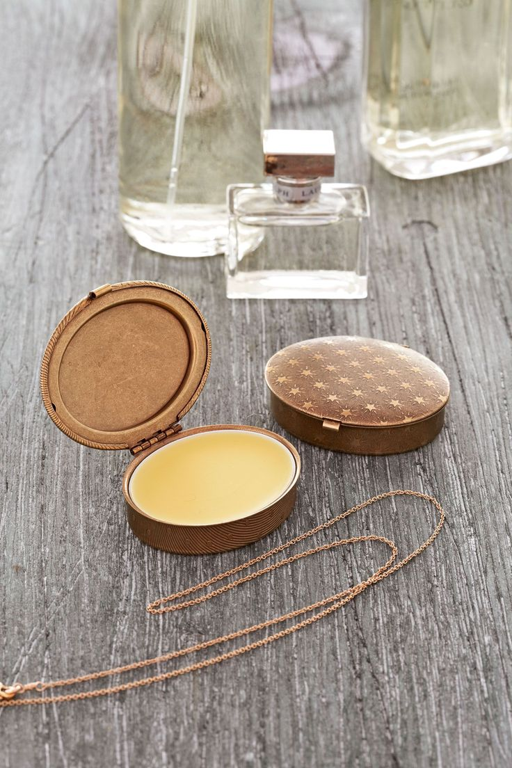 To create your own signature scent, first take two perfume compacts and place a liner in each (oval perfume compact, $12.95; large oval liner, $1.35; ladyofthelockets.etsy.com). Then, mix 1½ teaspoons of jojoba oil and 25 drops of essential oil—rose, lavender, your choice!—in a glass; set aside (jojoba oil, $5.97 for 2 oz.; essential oils, from $2.95; bulkapothecary.com). Melt ¾ teaspoon of grated beeswax on low heat in a glass bowl over a double boiler for 5 to 10 seconds (white beeswax…