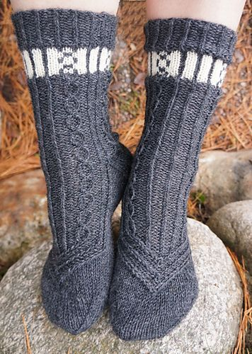 Chained Socks design is a basic cuff down sock pattern that combines an easy stranded knitting pattern with a corresponding cable pattern. The design is suitable for those knitters who are relatively new to stranded knitting and traveling stitches / moderate cabling.