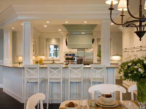Cute kitchen. Custom designed stone island and hood. Quality appliances. And a 25-foot long peninsula that seats 8 people.