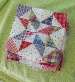 I like the polka dot fabric with the plaid....Scrap Quilts Again.  Nice way to use those HST scraps.